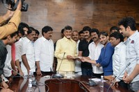TCA and Sri Mitra Donate Cheque to CM